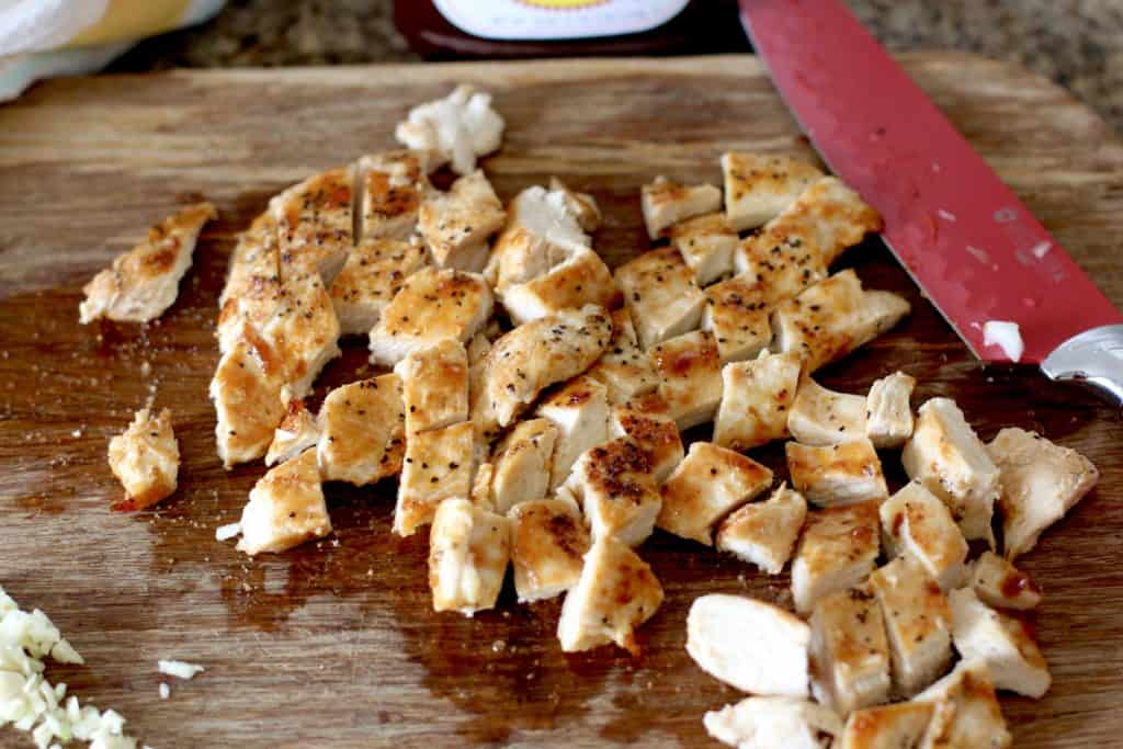 diced cooked chicken on a cutting board