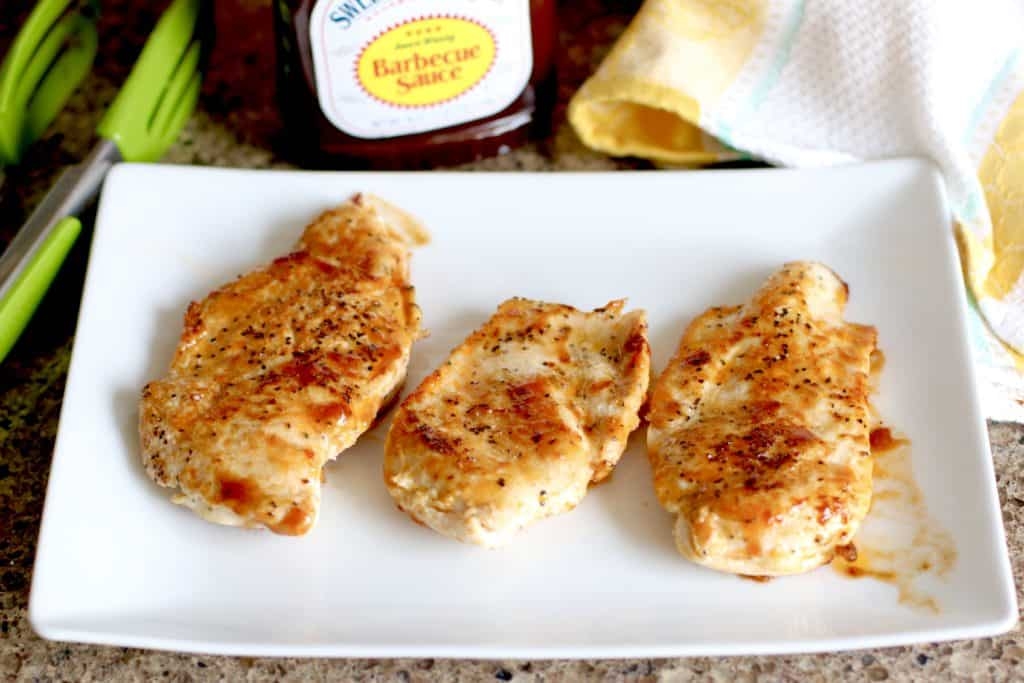 chicken breasts, fully cooked and set aside on a white platter