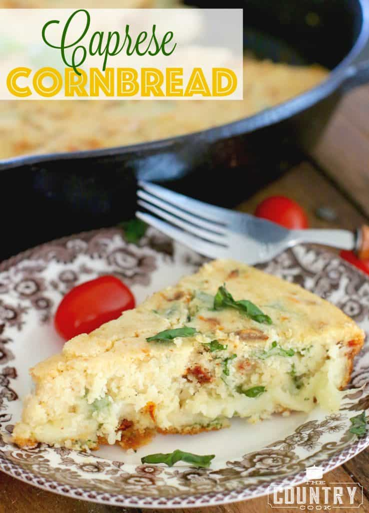 Skillet Caprese Cornbread recipe from The Country Cook, shown as a slice on a white and brown plate with a fork on the side