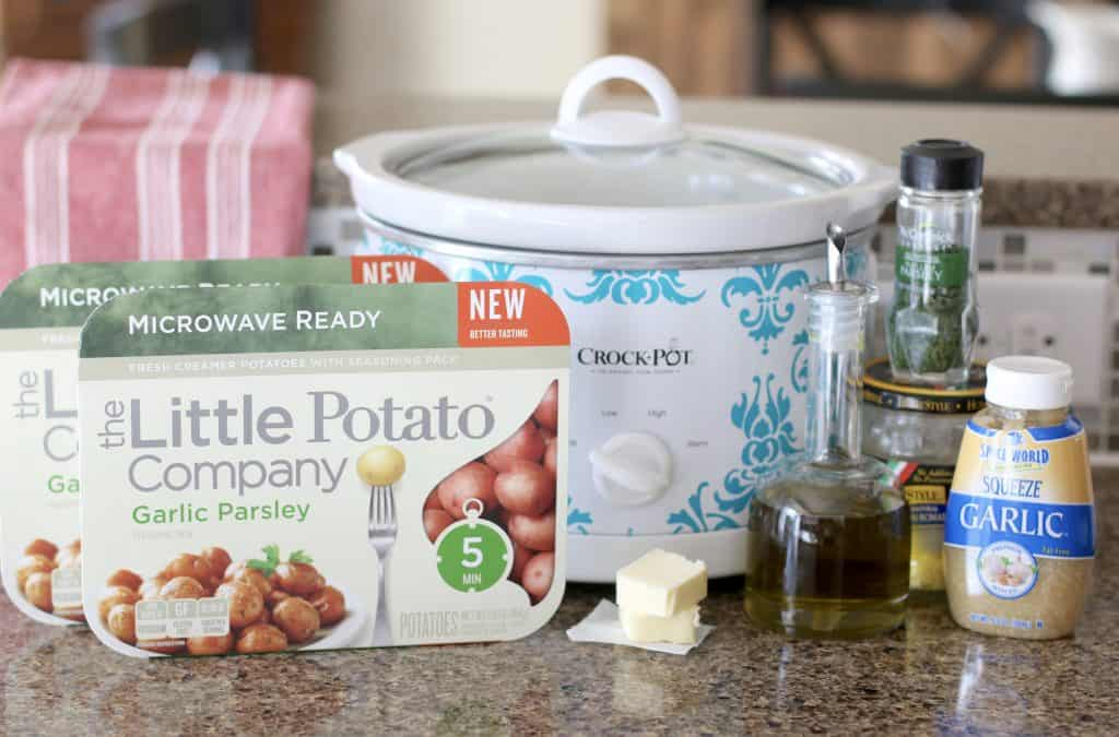 Ingredients needed for Crock Pot Garlic Parmesan potatoes: Garlic Parsley Microwave Ready Little Potatoes, olive oil, salted butter, minced garlic, shredded parmesan cheese, dried parsley
