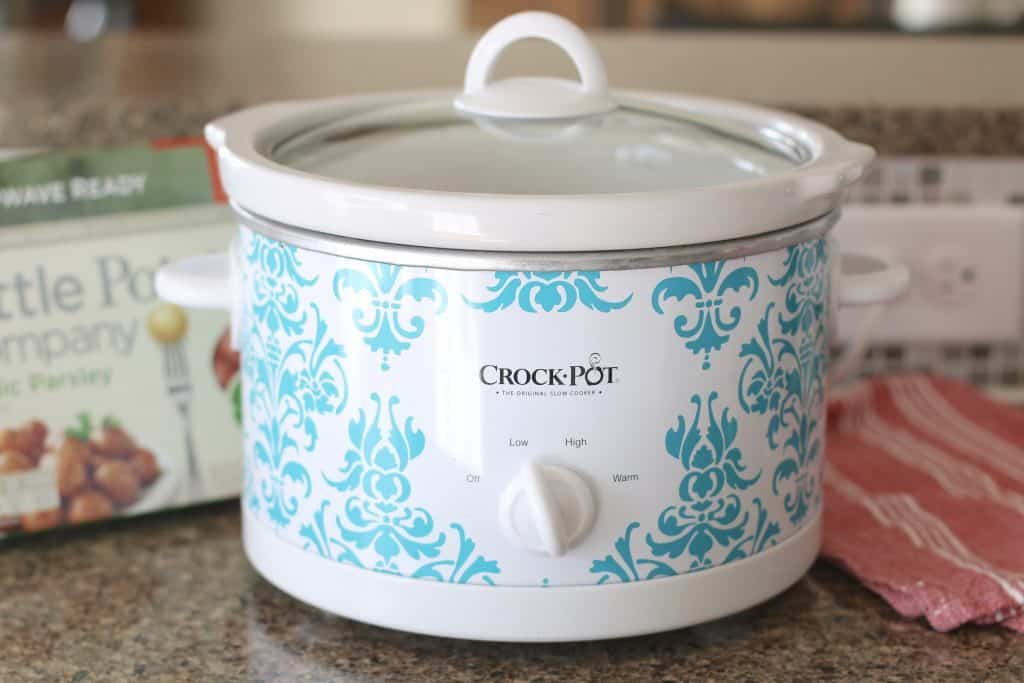 white and blue slow cooker with the cover on