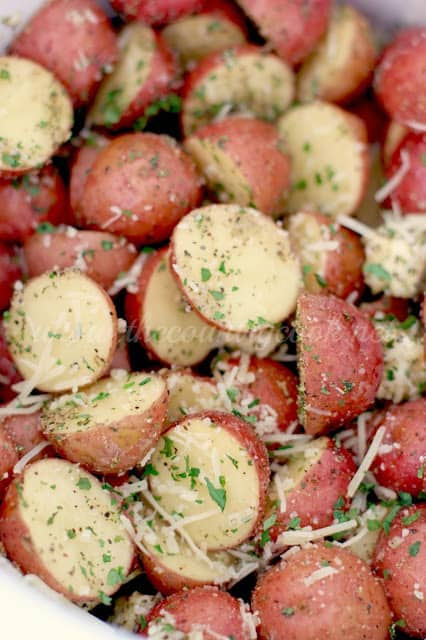 close up of Garlic Parmesan Potatoes with fresh parsley