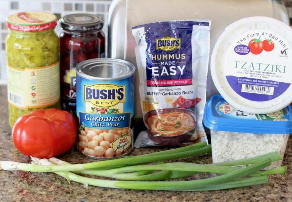 hummus, tzaziki dip, pepperoncini, kalamata olives, diced tomatoes, diced green onions, Feta cheese