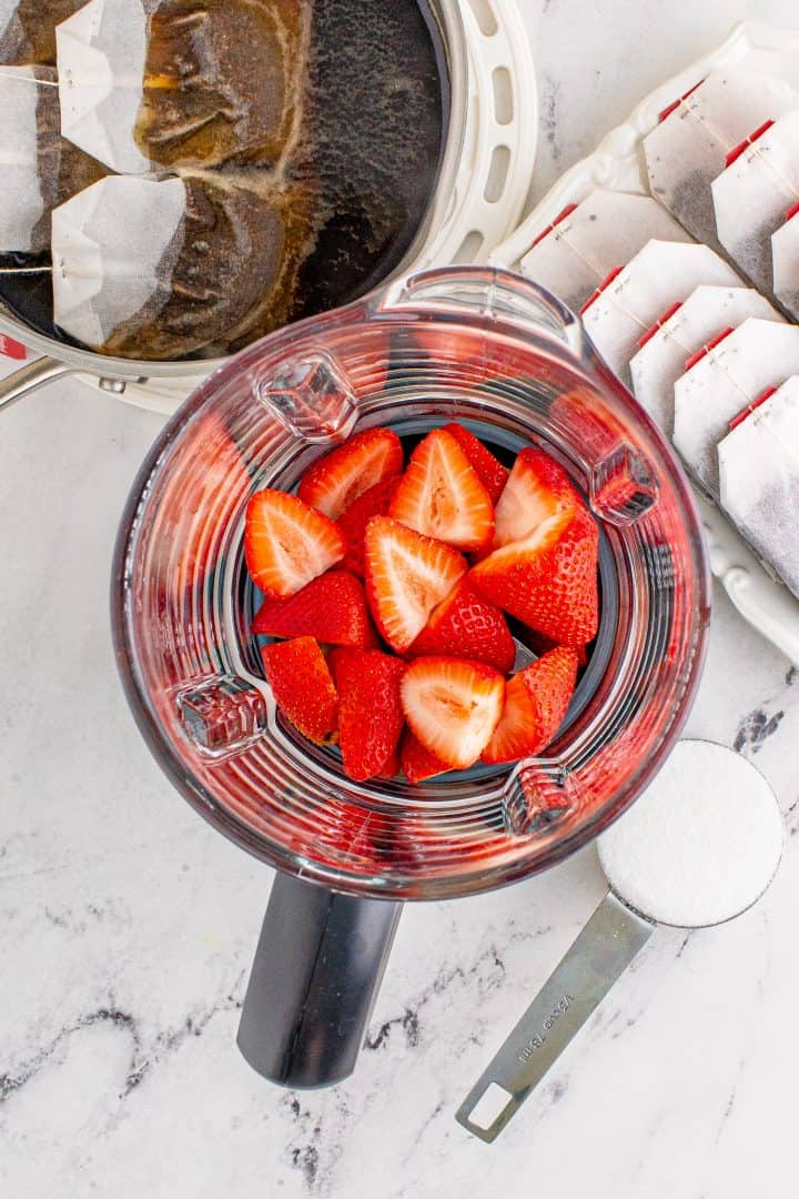 sliced strawberries in a food processor