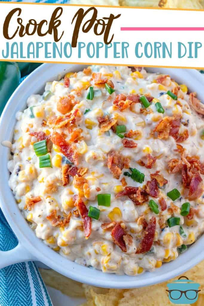 Crock Pot Jalapeno Popper Corn Dip recipe from The Country Cook served in a white bowl and topped with bacon bits and sliced green onions