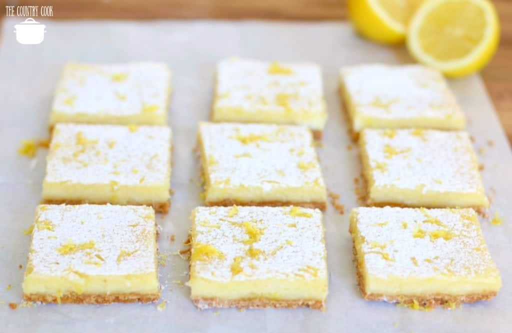 Cream Cheese Lemon Bars, sliced with fresh lemons
