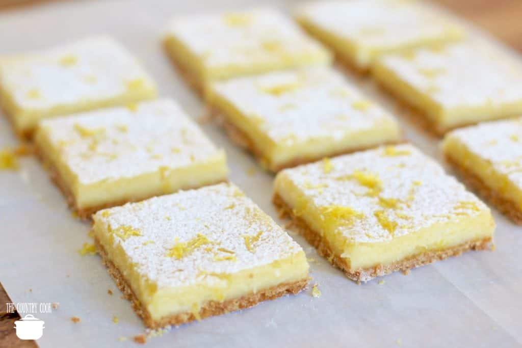 Creamy Lemon Bars with fresh lemon juice topped with powdered sugar