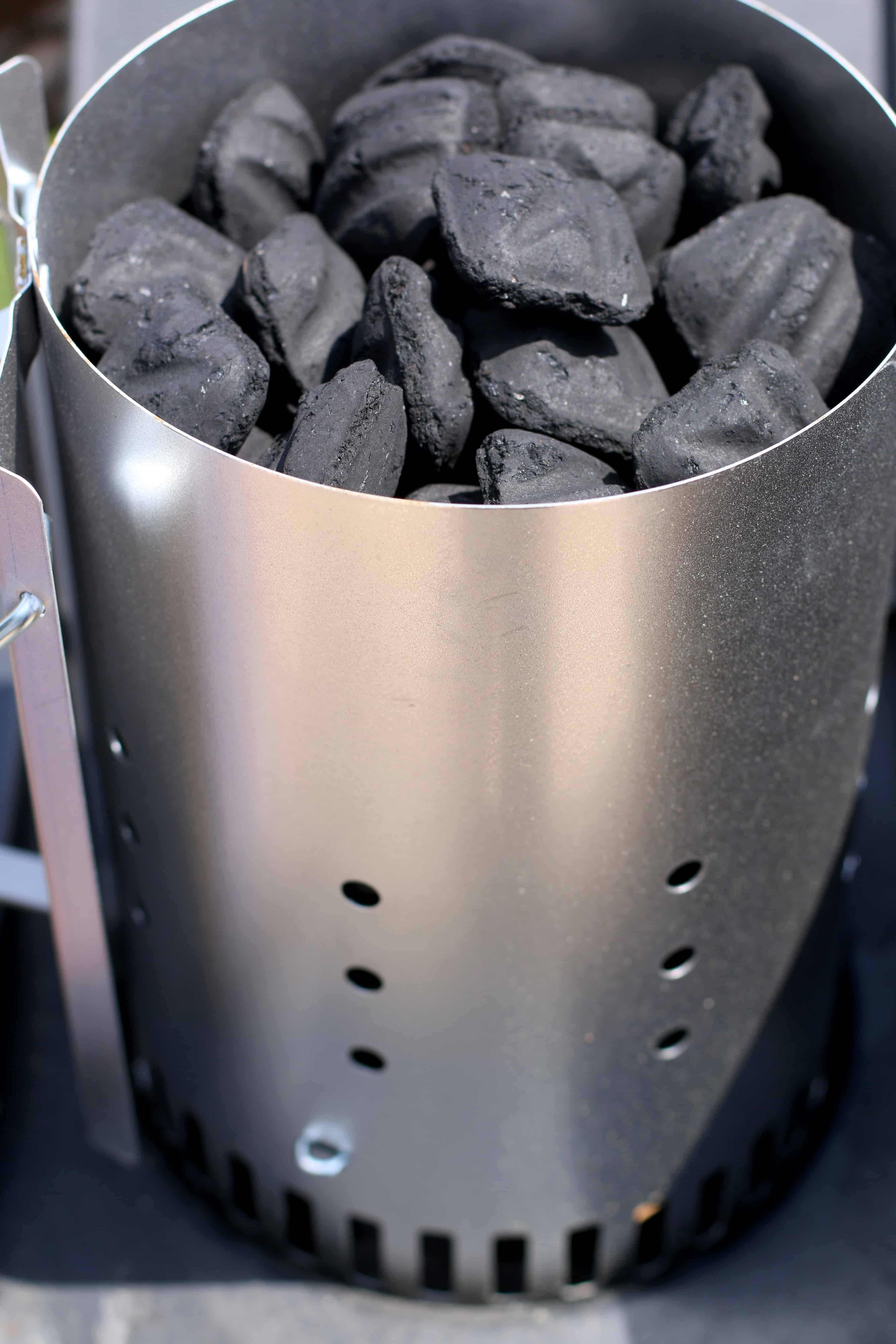 charcoal briquets in a chimney starter