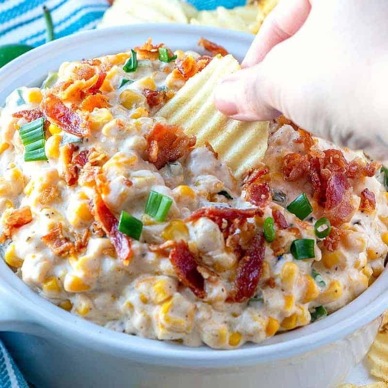 Crock Pot Jalapeno Popper Corn Dip dipped with a chip