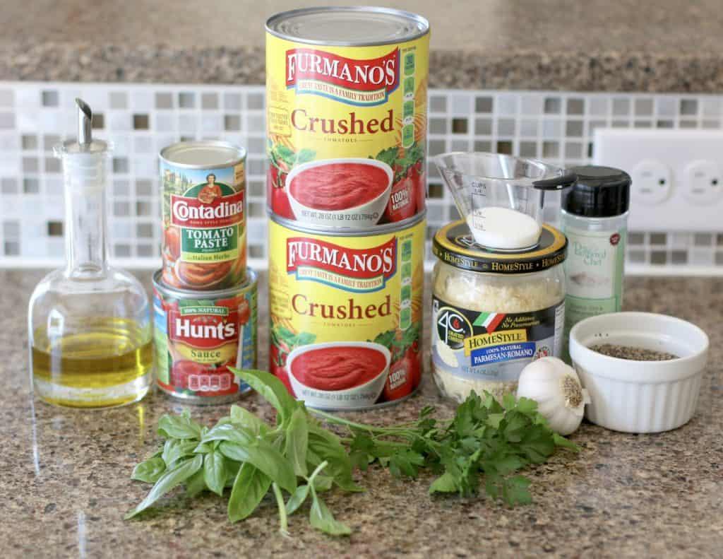 extra virgin olive oil, garlic cloves, crushed tomatoes, tomato sauce, tomato paste, water, grated Parmesan Romano, sugar, fresh basil, fresh parsley, fresh oregano, pepper