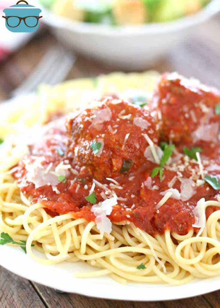 Homemade Marinara Sauce and Meatballs on top of spaghetti noodles and topped with frehly grated Parmesan cheese