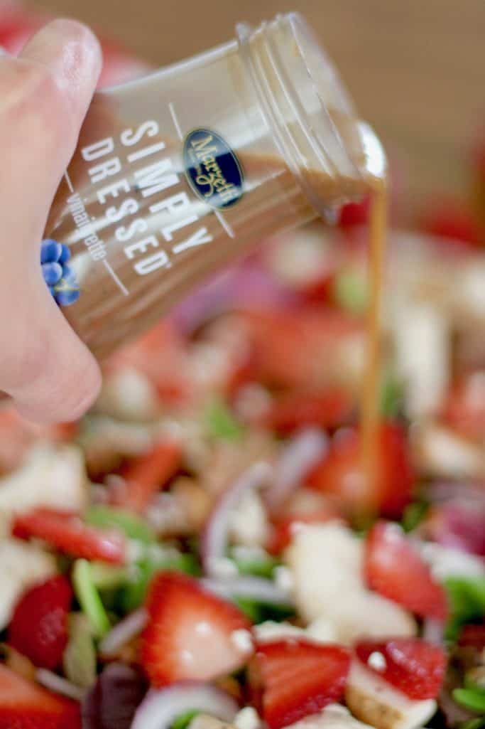 balsamic vinaigrette dressing poured over Strawberry Fields Salad