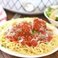 Slow Cooker Homemade Italian Marinara Spaghetti Sauce with Homemade Beef Meatballs on top of cooked spaghetti