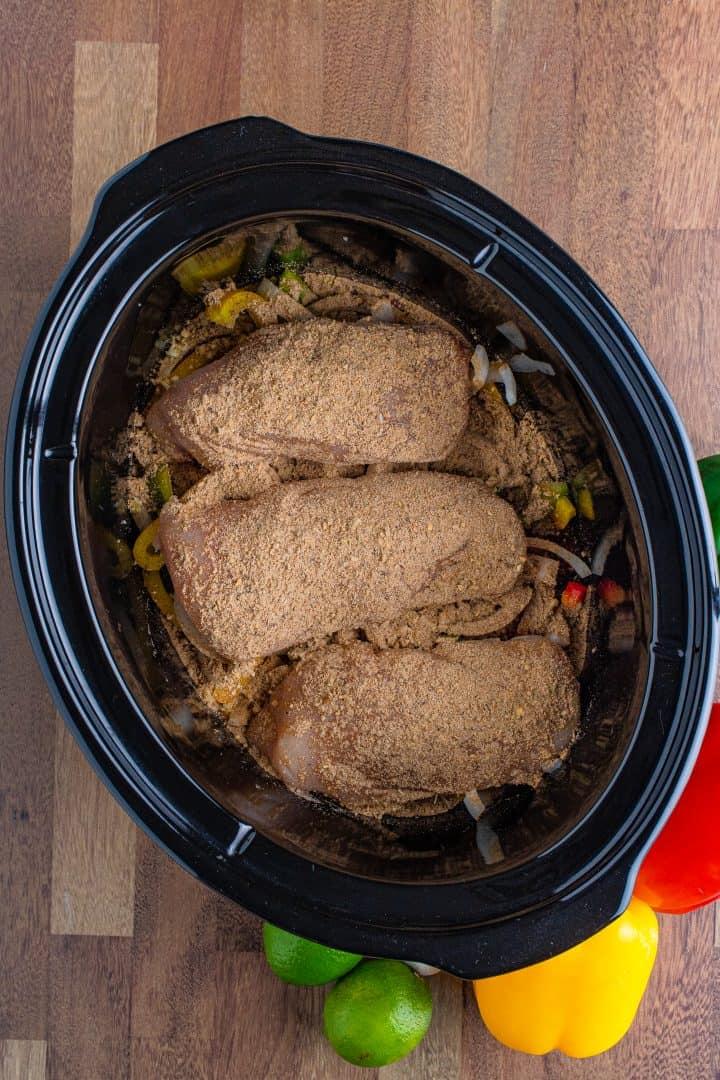 fajita seasoning evenly sprinkled on top of fresh chicken breasts.