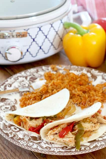 chicken fajitas served with Mexican rice