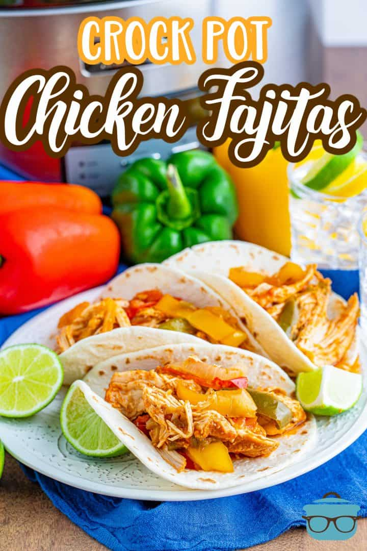 Crock Pot Chicken Fajitas recipe from The Country Cook, fajita filled flour tortillas shown on a white plate with slices of lime.