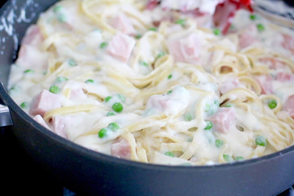 Creamy Ham Fettuccine mixture in a large skillet