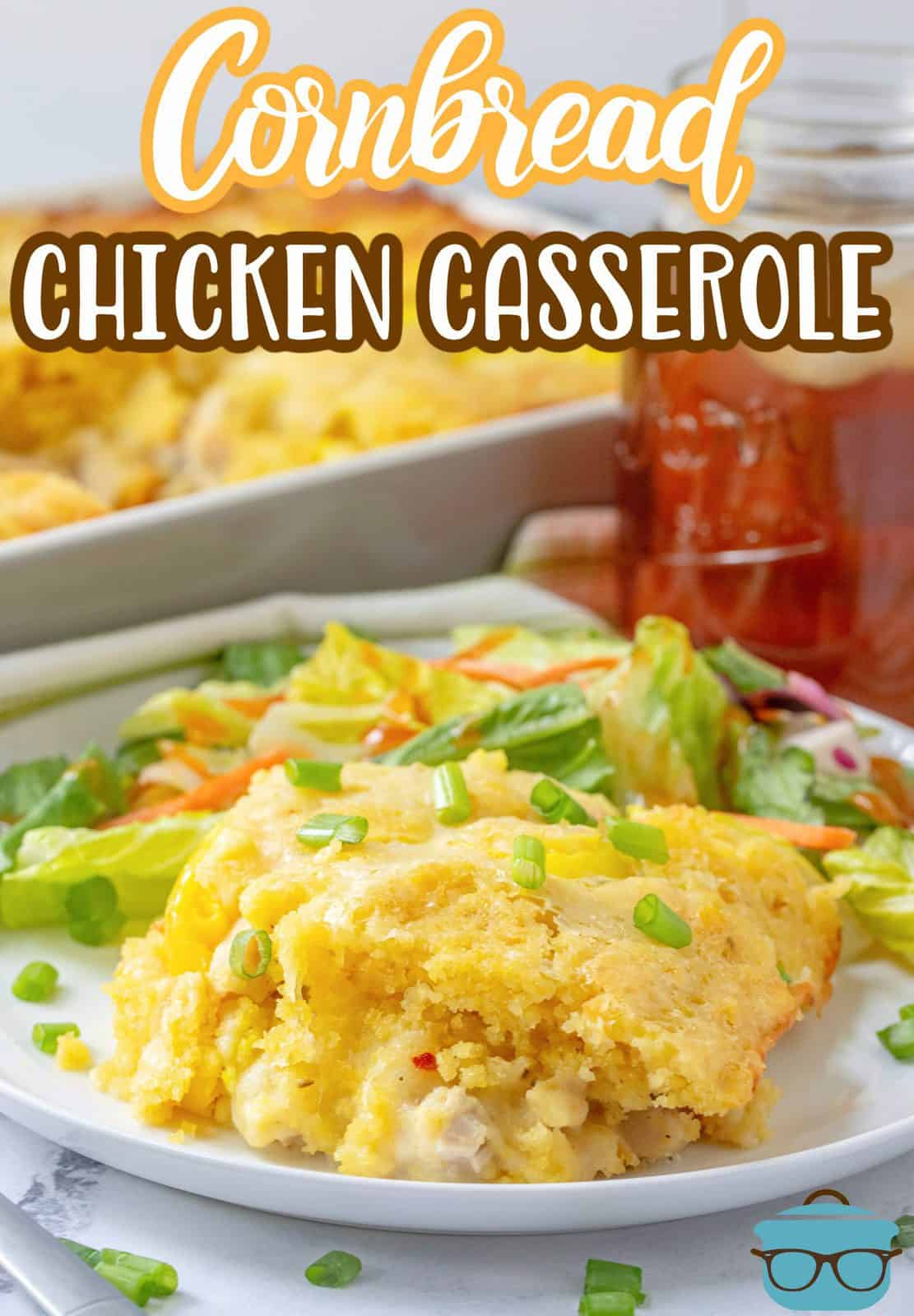 Easy Cornbread Chicken Casserole recipe from The Country Cook. Slice of cornbread casserole shown on a round white plate with a side salad.