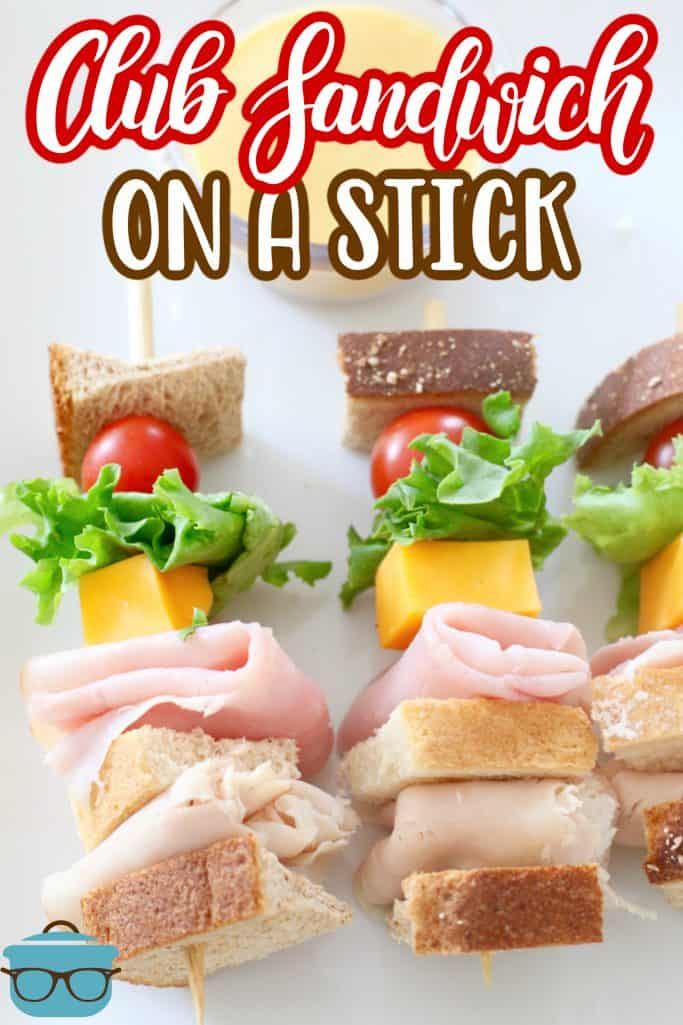 Club Sandwich on a Stick, two club sandwiches on a stick shown on a white plate