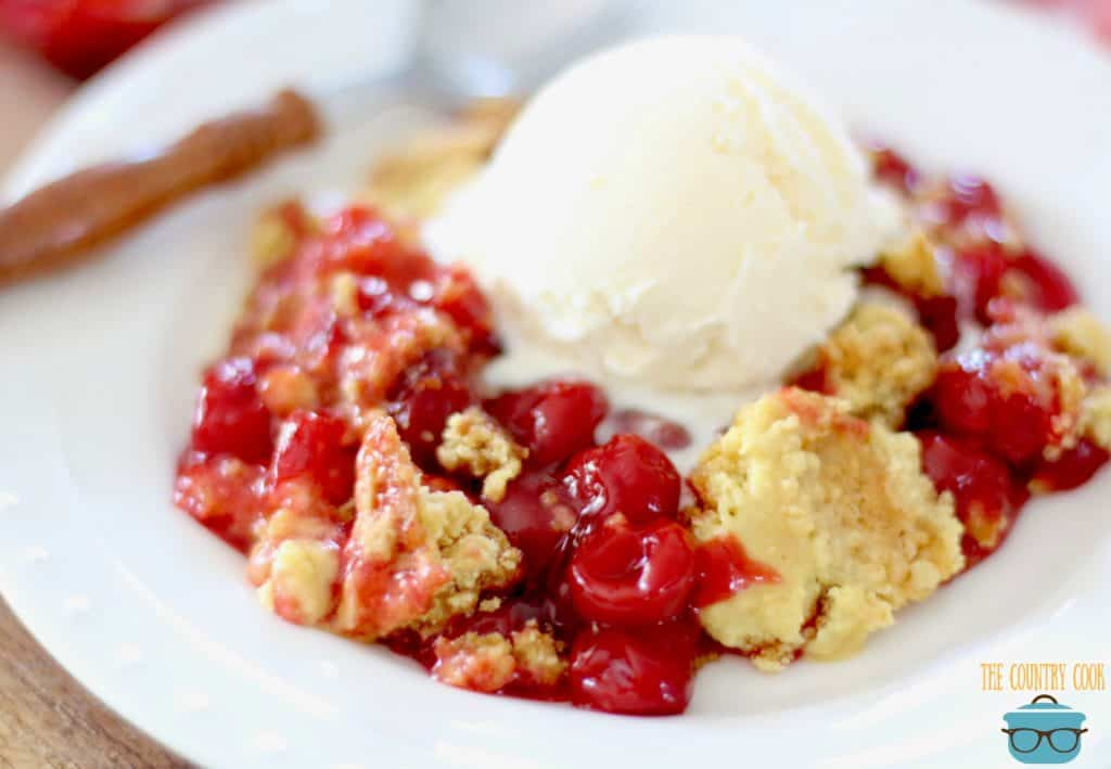 Easy Cherry Dump Cake with a scoop of vanilla ice cream