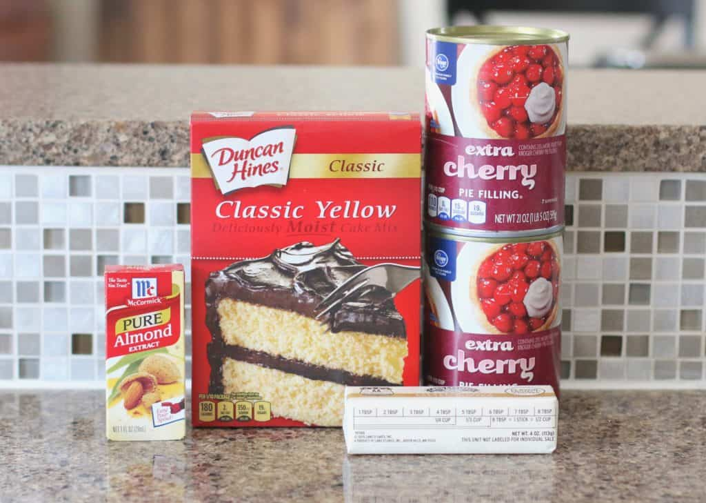 yellow boxed cake mix, two cans cherry pie filling, salted butter, almond extract