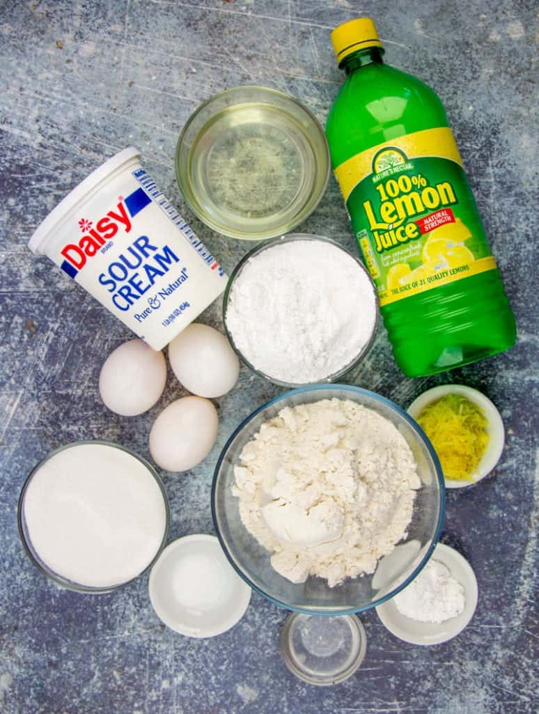 lemon juice, flour, sour cream, eggs, sugar, lemon zest, oil, powdered sugar