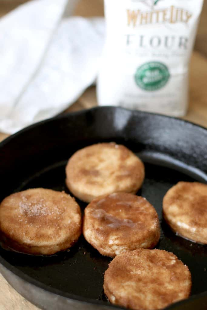 cinnamon sugar coated biscuits in cast iron skillet