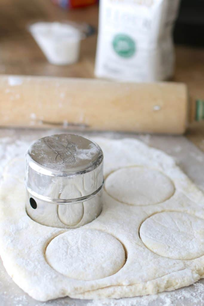 biscuit dough cutter cutting out homemade biscuits