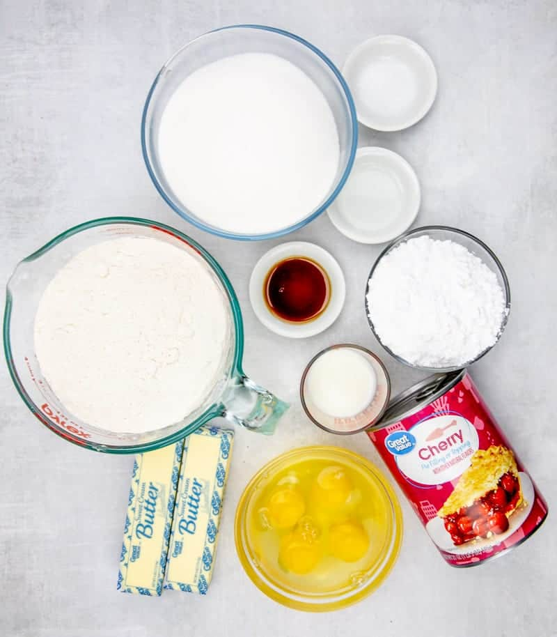 ingredients shown: cherry pie filling, flour, butter, vanilla, eggs, sugar, almond extract