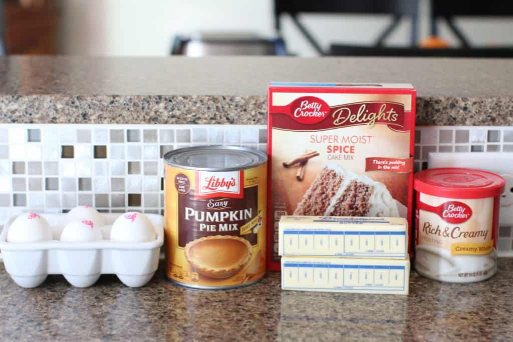 boxed spice cake mix, eggs, pumpkin pie filling, butter, tub of vanilla frosting