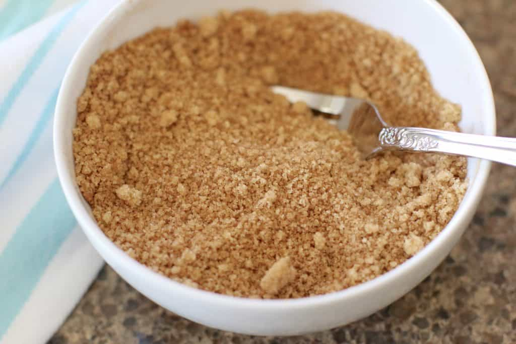 brown sugar and ground cinnamon mixed together with a fork in a small white bowl