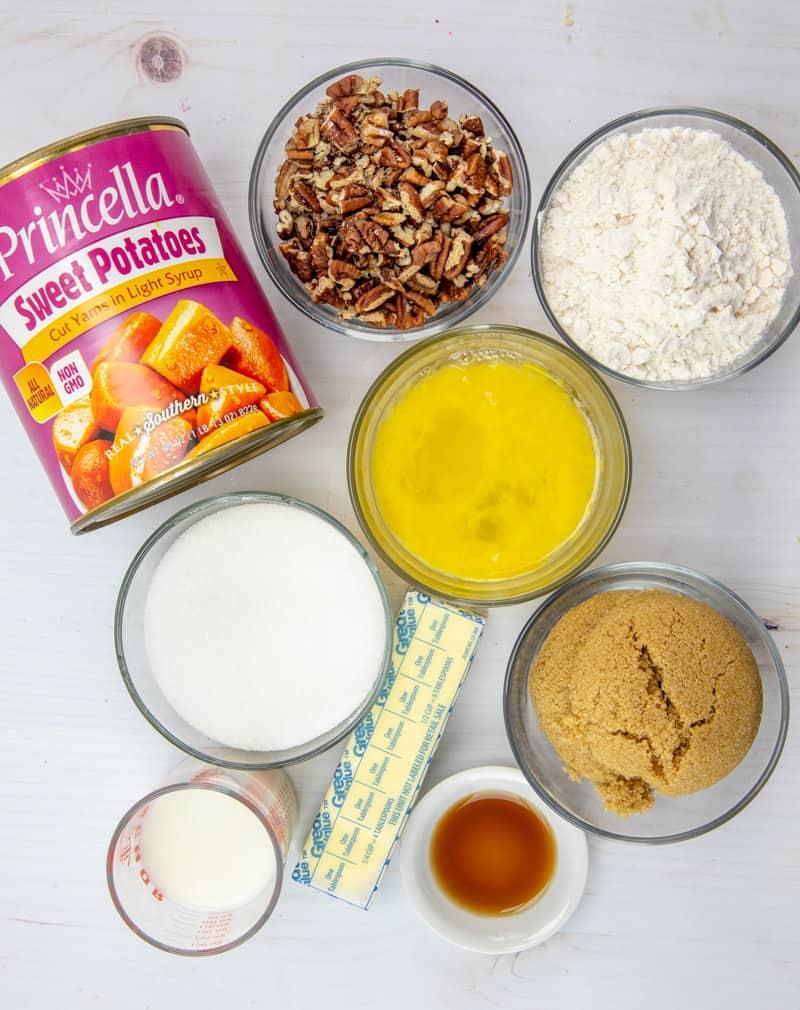 canned sweet potatoes, milk, sugar, vanilla extract, eggs, salt, brown sugar, flour, chopped pecans
