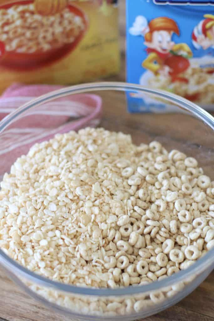 Rice Krispies and honey nut cheerios mixed together in a bowl