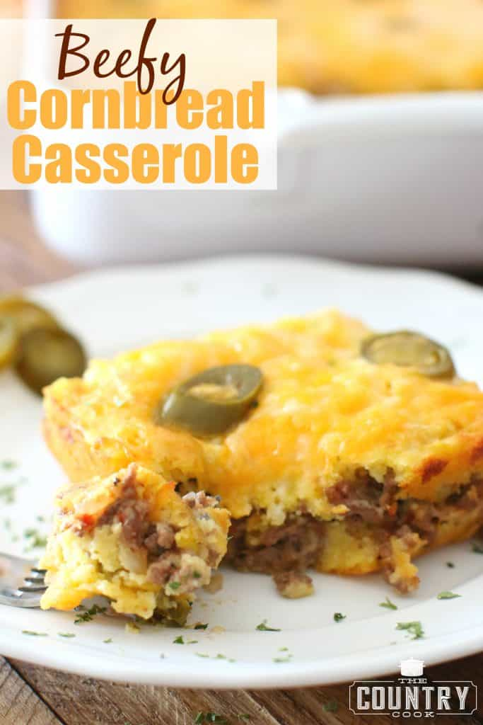 Beefy Cornbread Casserole recipe from The Country Cook, slice shown on a white plate with a bite removed