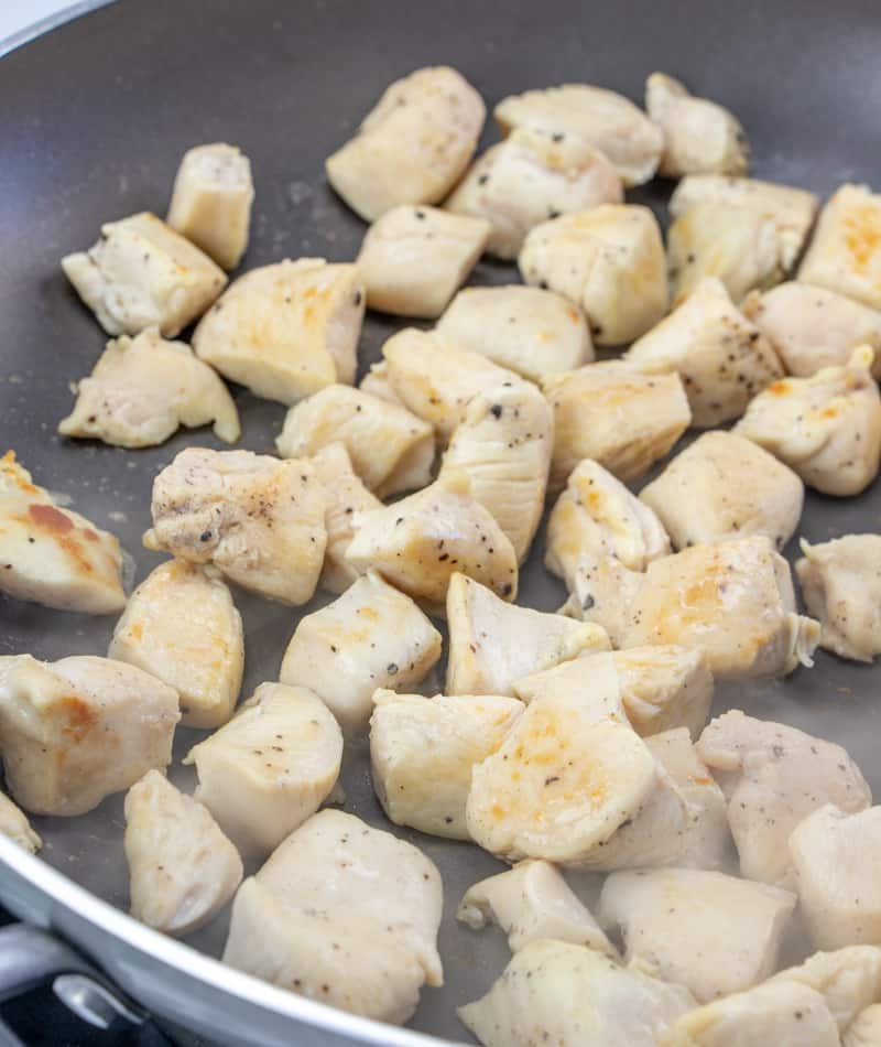 diced chicken breasts placed into skillet
