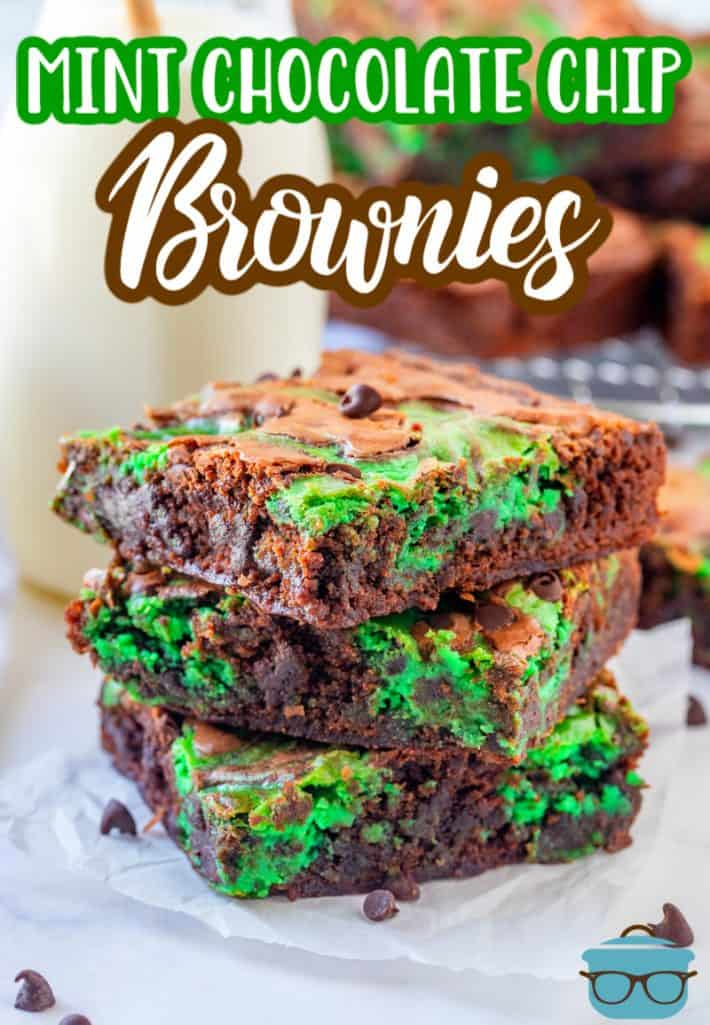 Mint Chocolate Chip Brownies recipe from The Country Cook - three slices of brownies stacked on top of each other on a square of parchment paper