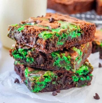 Mint Chocolate Chip Brownies recipe from The Country Cook, three slices of brownie shown stacked on top of each other