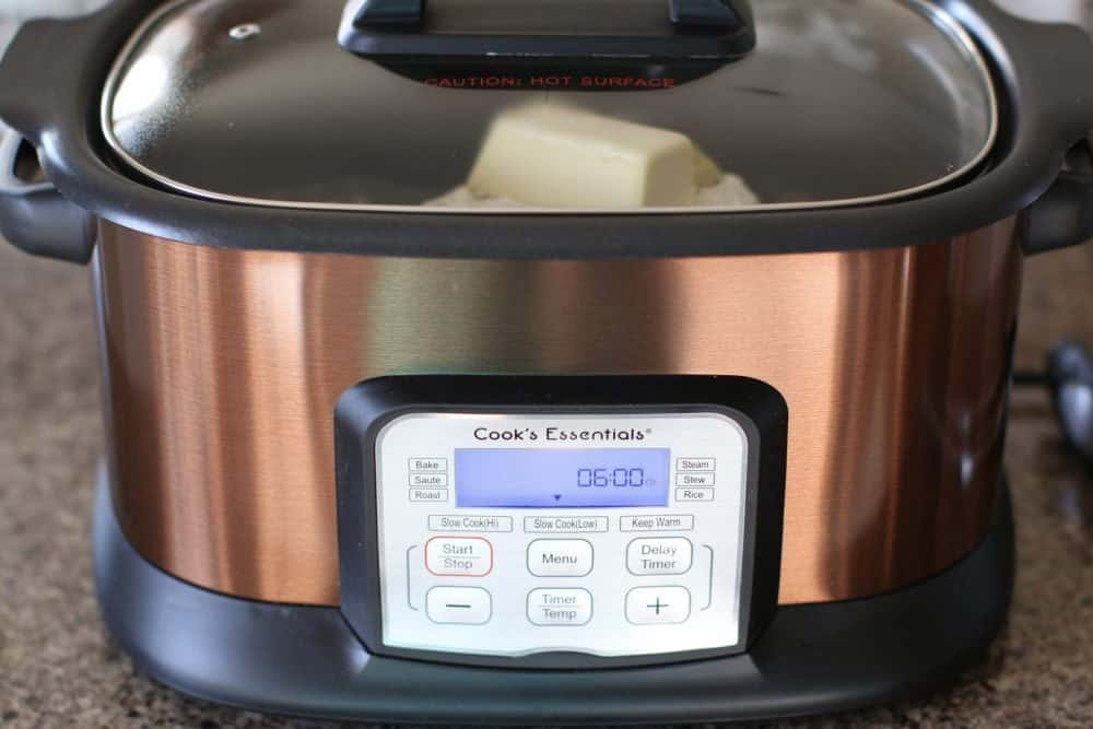 slow cooker shown with a digital display showing it set for 6 hours.