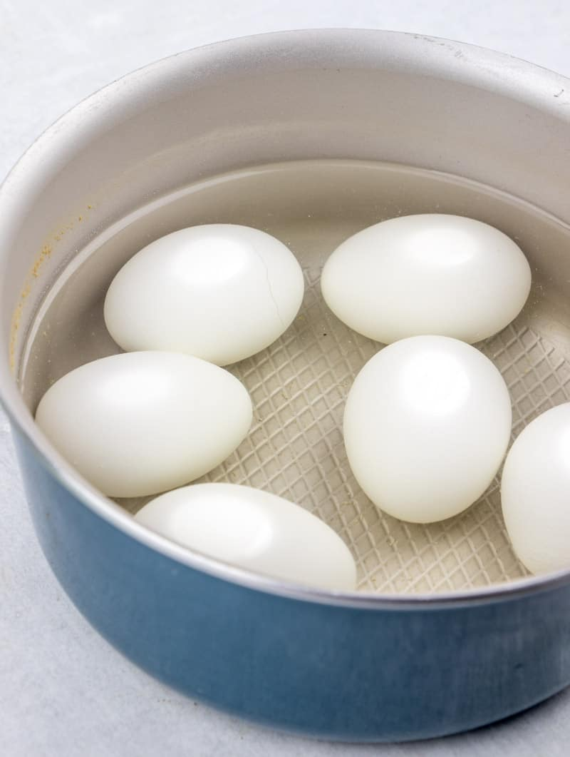 eggs covered in water in a large saucepan.