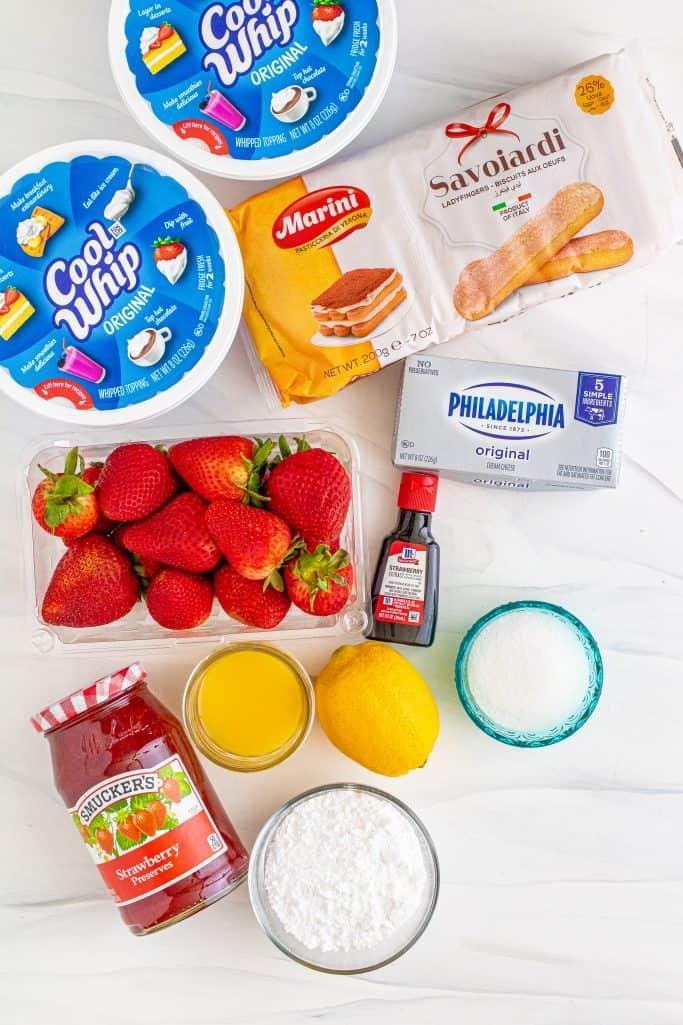 fresh strawberries, sugar, fresh lemon juice, cream cheese, powdered sugar, strawberry preserves, lady fingers, orange juice, Cool Whip whipped topping