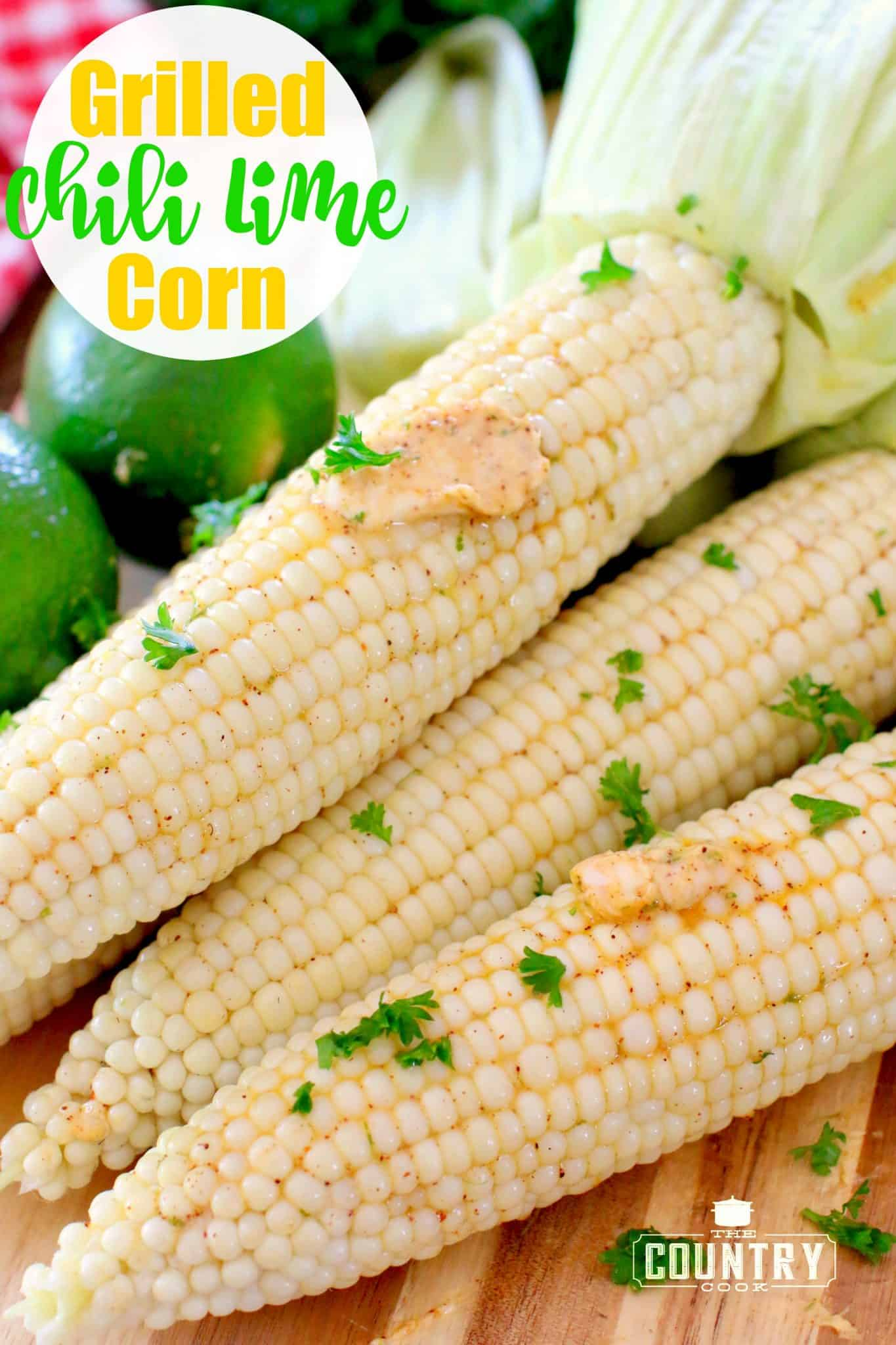 Grilled Chili Lime Corn shown close up with melted butter and chopped fresh parsley sprinkled on top.