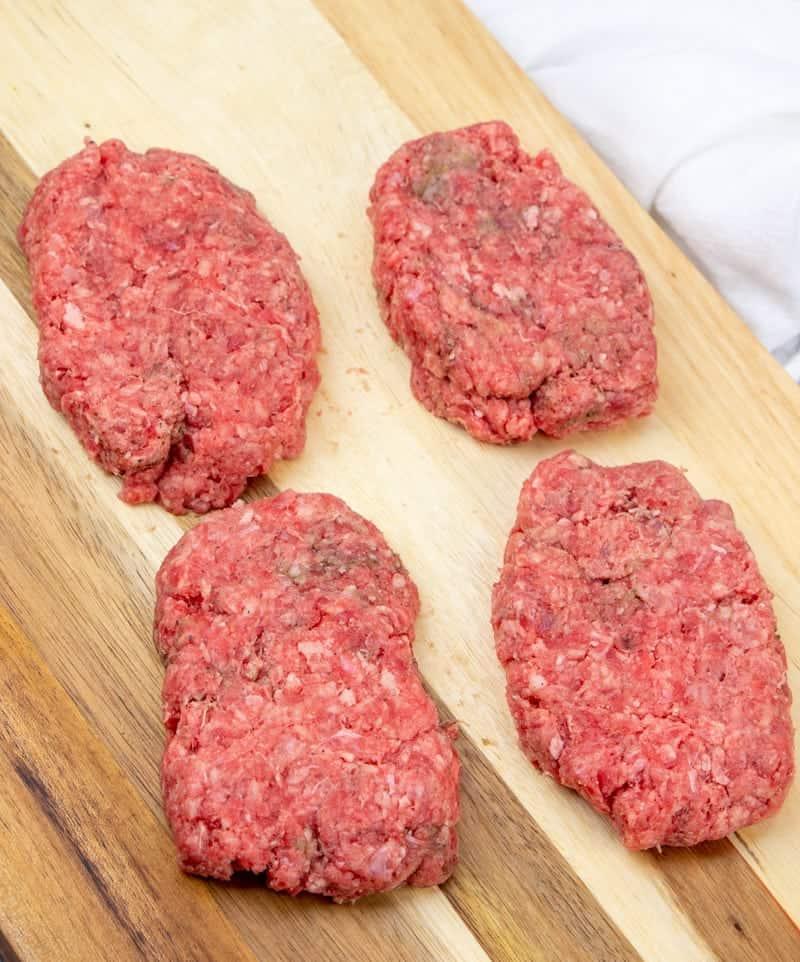 formed hamburger patties on a cutting board