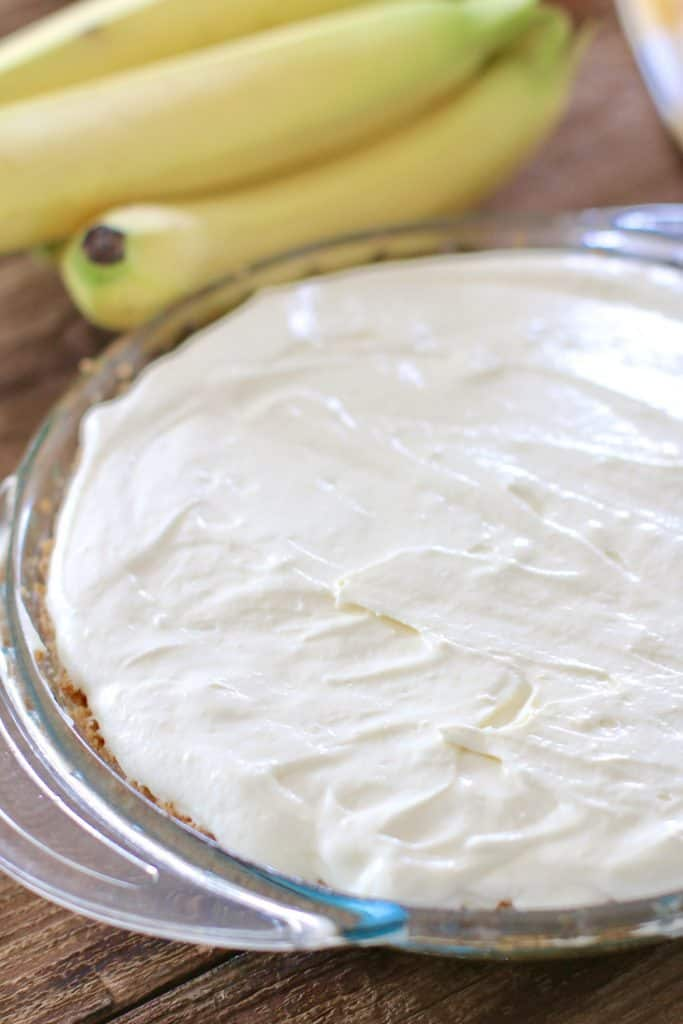 banana cream pie filling poured on top of bananas
