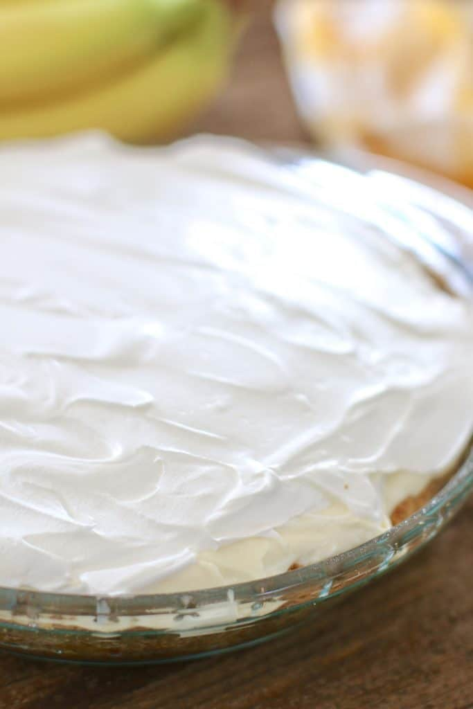 Cool Whip whipped topping spread on top of banana cream pie filling