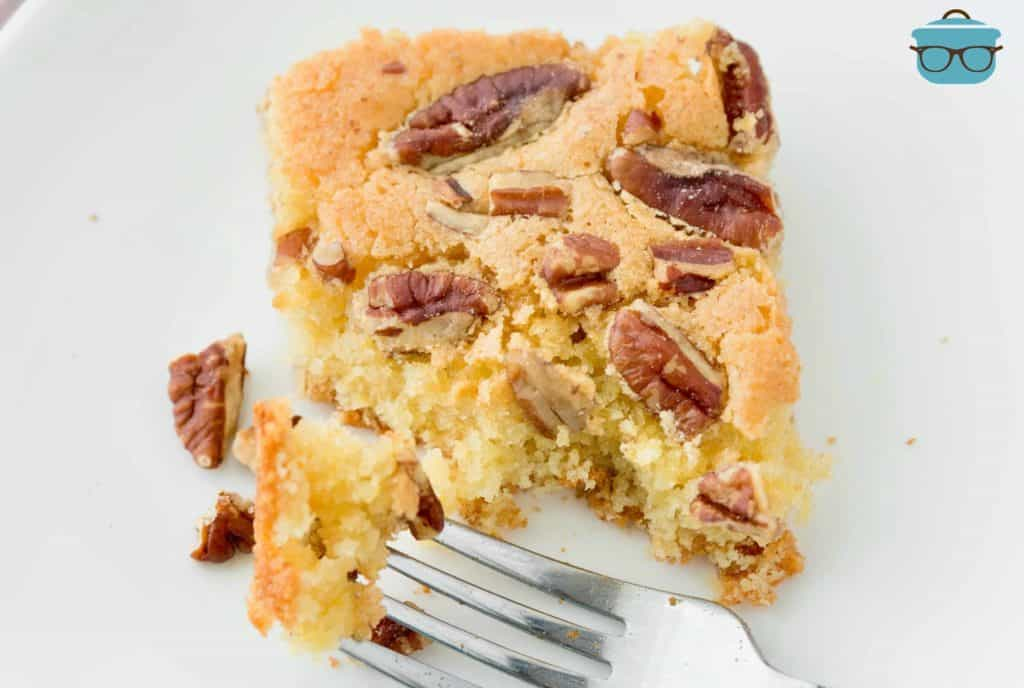 Sweet Southern Pecan Cake on a white plate with a fork