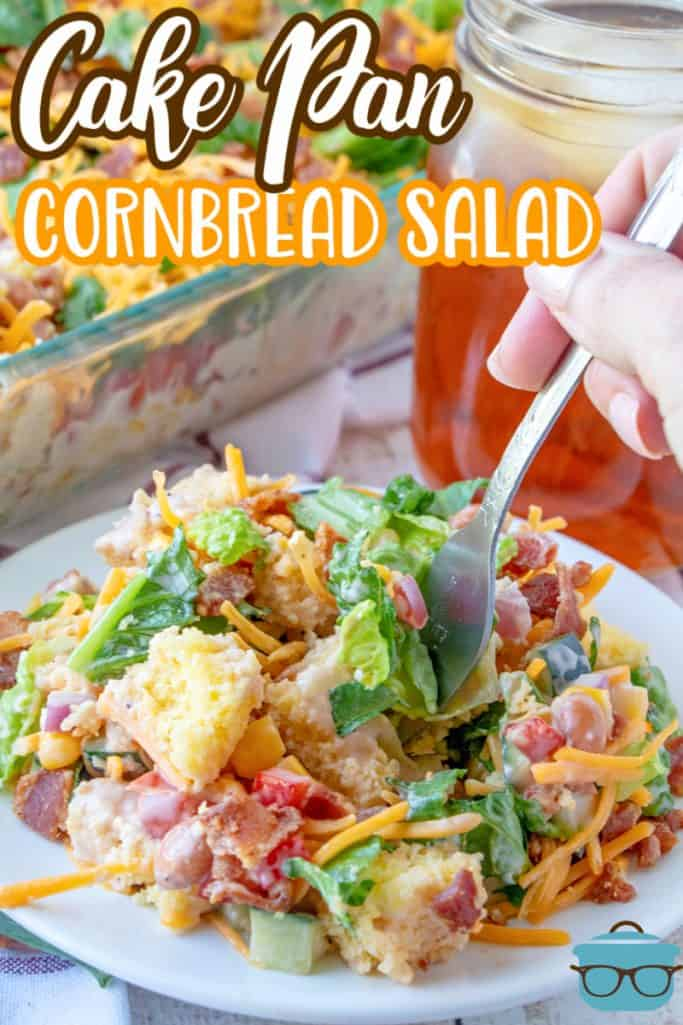 Southern Cake Pan Cornbread Salad recipe from The Country Cook, serving of cornbread salad shown on a small round plate with a fork inserted into the salad