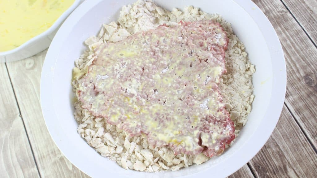 coating cubed steak in cracker topping