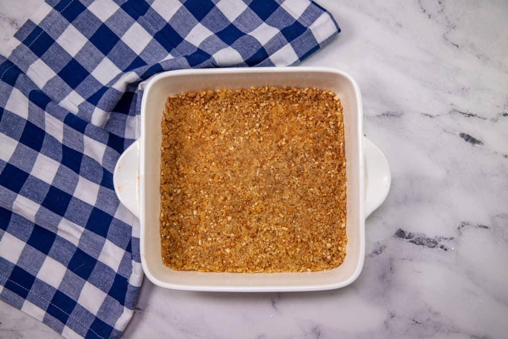 vanilla wafer mixture spread into a square baking dish