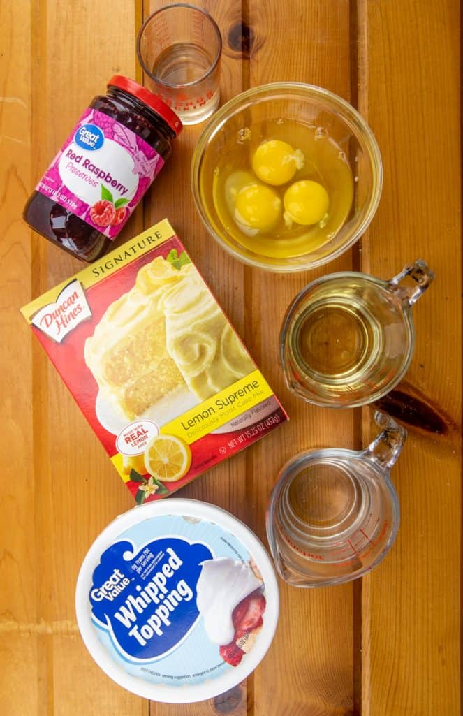 lemon raspberry poke cake ingredients: lemon cake mix, eggs, oil, water, raspberry preserves, water, frozen whipped topping