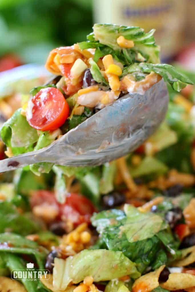 Vegetarian Taco Salad scooped with salad tongs